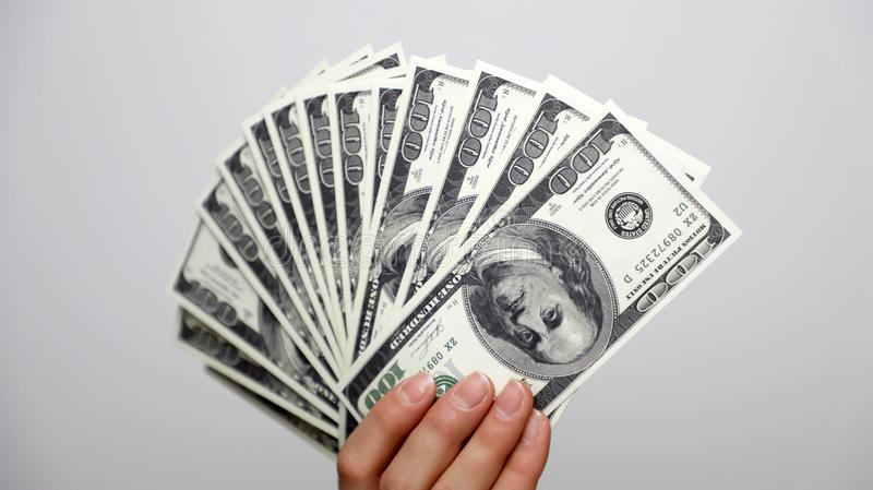 Dollars in hand. Fan of money stock images