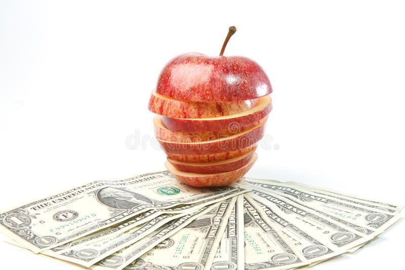 Dollars Lays On An Apple Stock Image