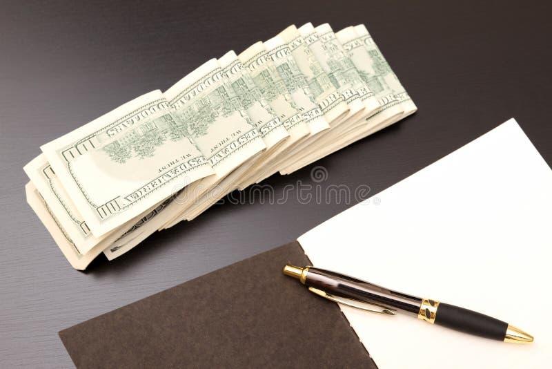 Dollars met een voorbeeldenboek royalty-vrije stock afbeeldingen