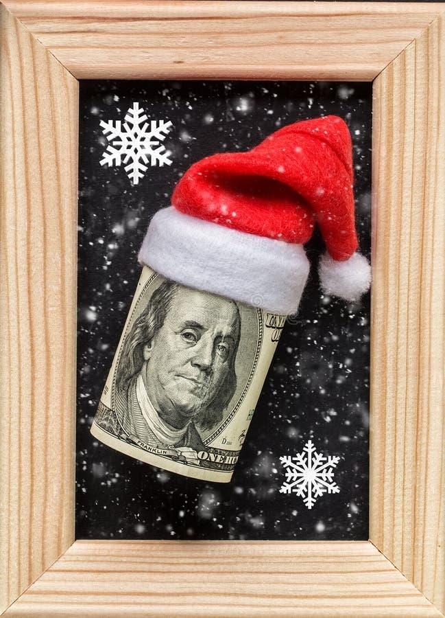 Dollars op houten fotokader Het concept van de de wintervakantie stock afbeelding