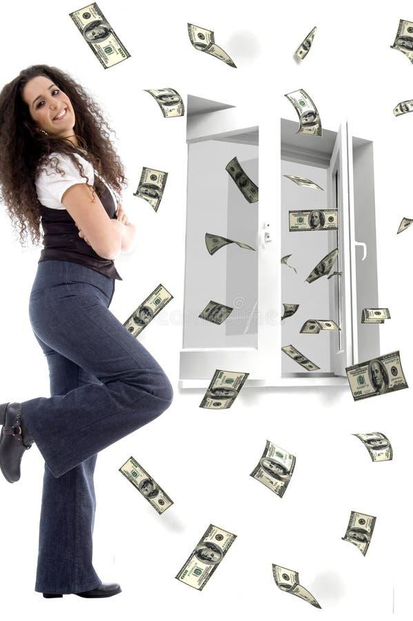 dollars pilotant les jeunes de sourire de femme images stock
