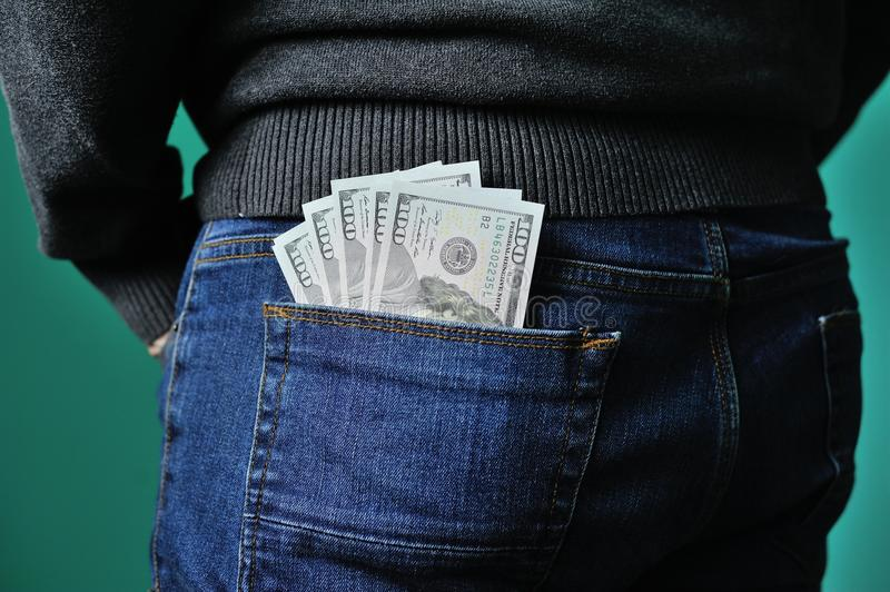 Dollars in the pocket of jeans stock photo