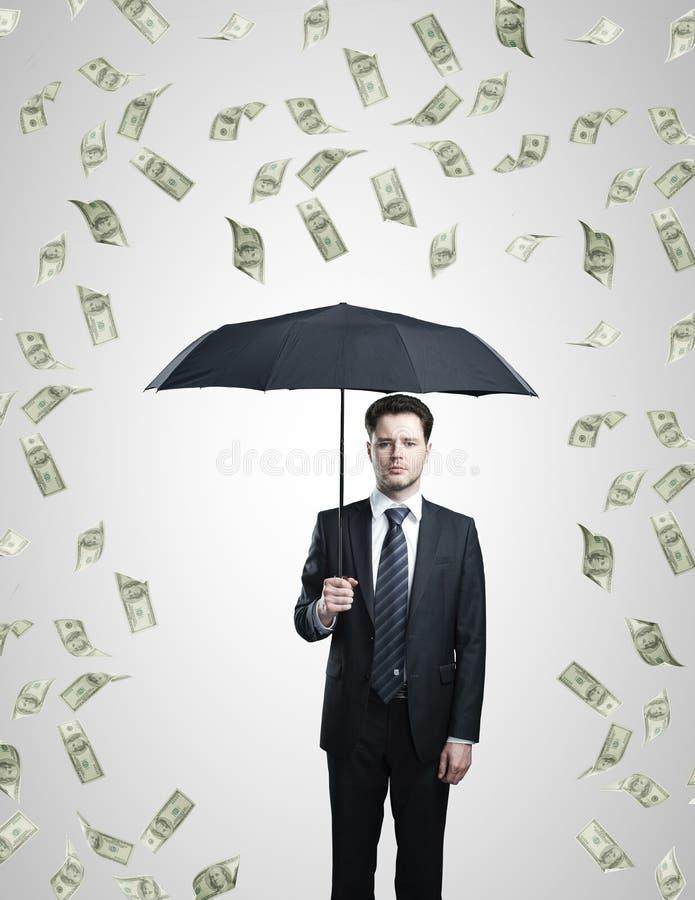 Dollars rain stock images