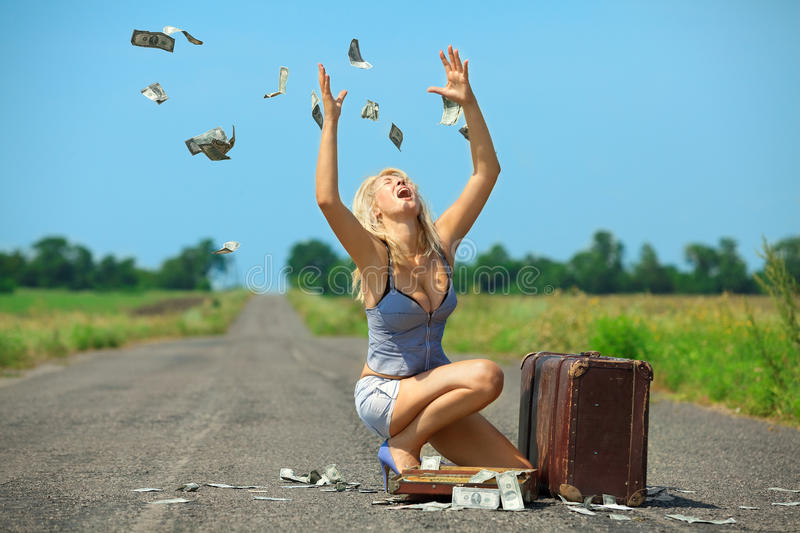 Dollars raining stock photography