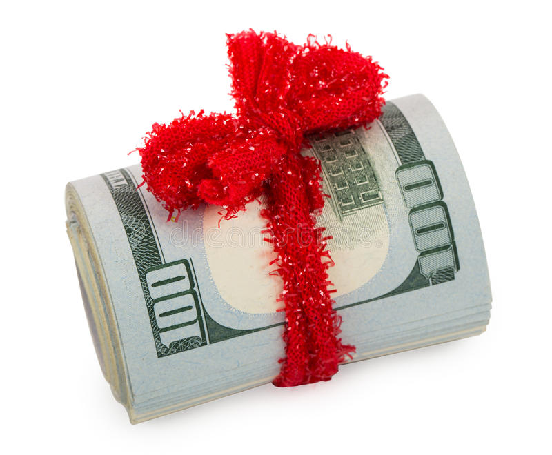 Dollars roll tied up with red ribbon royalty free stock photos