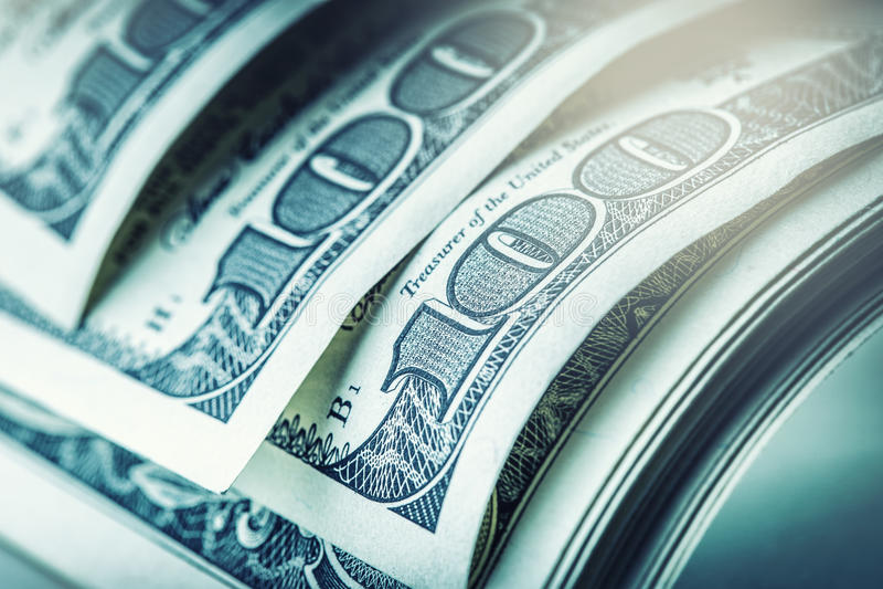 Dollars rolled closeup. American Dollars Cash Money. One Hundred Dollar Banknotes.  stock photos