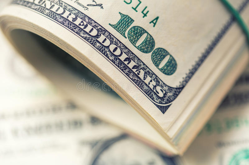 Dollars rolled closeup. American Dollars Cash Money. One Hundred Dollar Banknotes.  royalty free stock photos