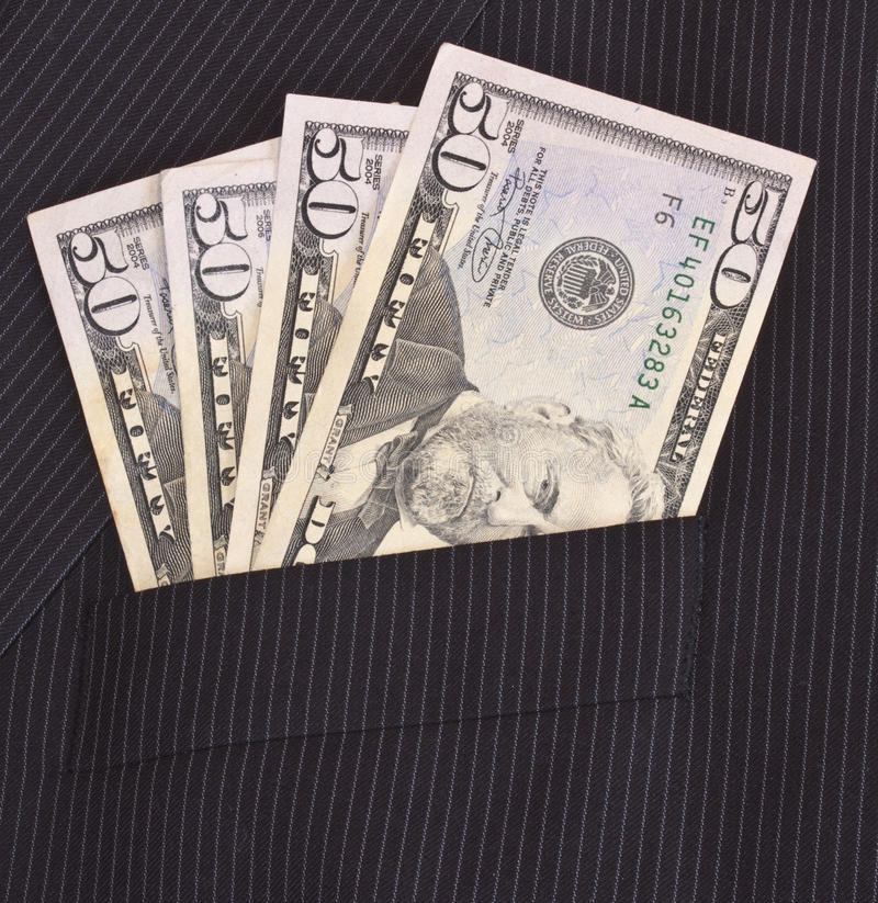 Dollars in suit pocket stock photo