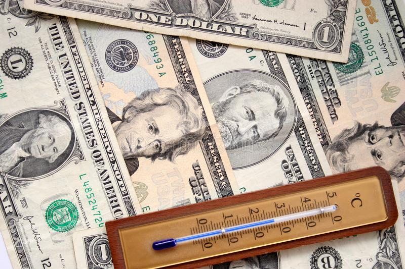Dollars and thermometer