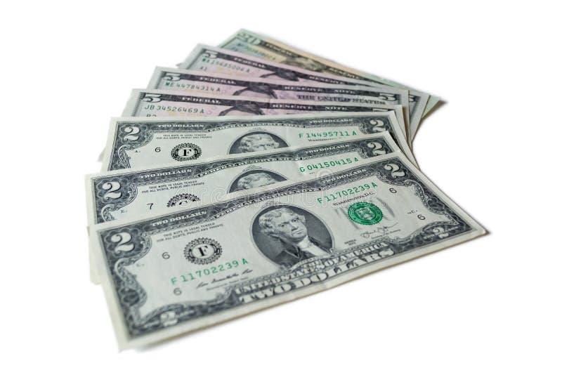 Dollars US : Factures de dollar US d'isolement sur le fond blanc photo libre de droits