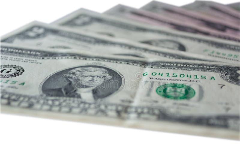 Dollars US : Factures de dollar US sur le fond blanc image stock