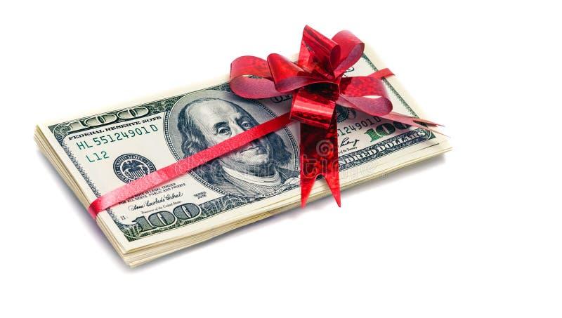 Dollarscheine mit rotem Bogenband-Geschenk revard lizenzfreie stockbilder
