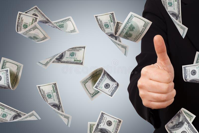 Dollarsedlar med bekräftelsetecknet av affärskvinnan royaltyfria bilder