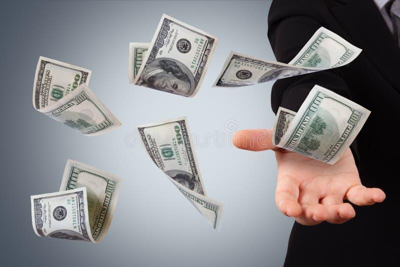 Dollarsedlar på ung affärskvinna arkivfoton