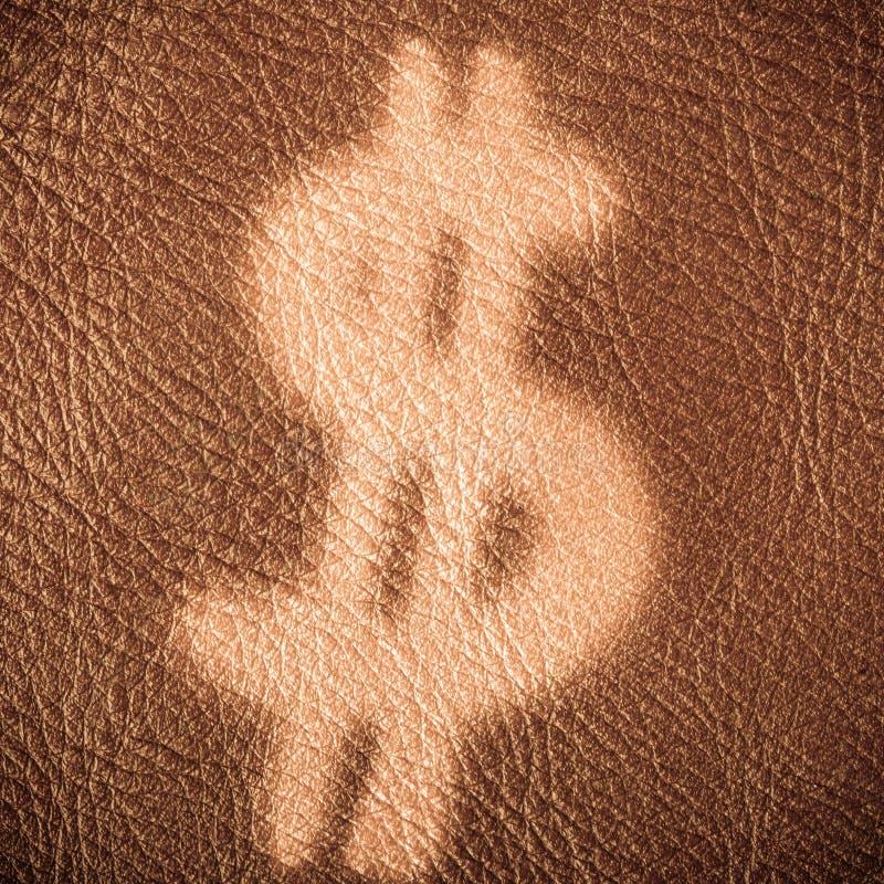 Dollarzeichen auf braunem ledernem Hintergrund Wirtschaftlichkeit und Finanzierung lizenzfreie stockfotografie