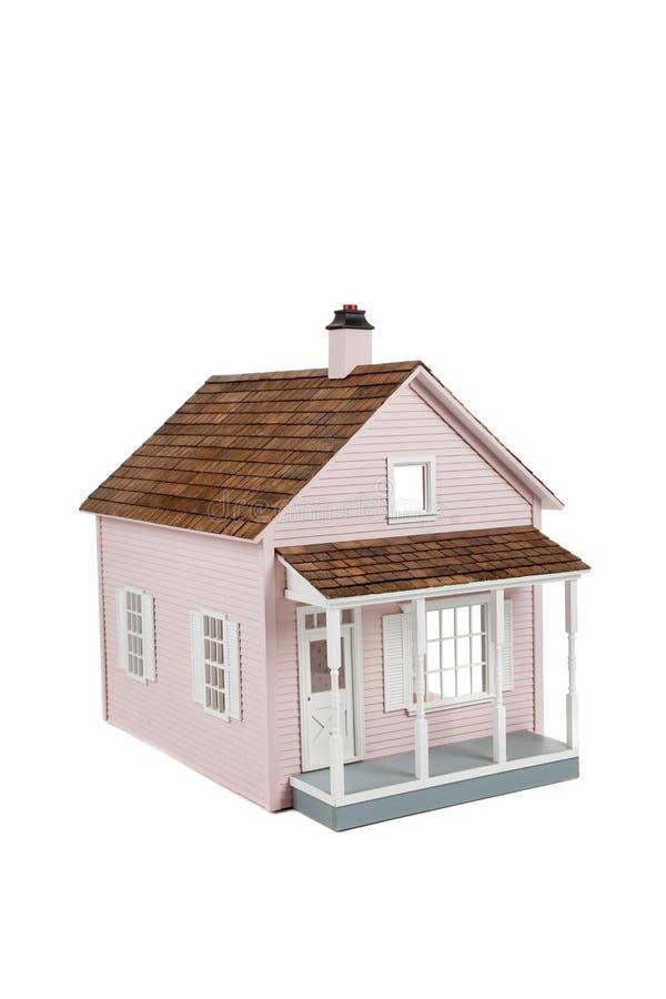 Dollhouse de madeira cor-de-rosa no branco fotografia de stock royalty free