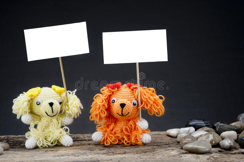 Download Dolls Dog Holding A Placard Royalty Free Stock Photos - Image: 26159858