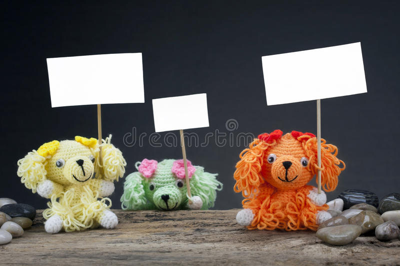 Download Dolls Dog Holding A Placard Stock Image - Image of doll, watching: 26166723