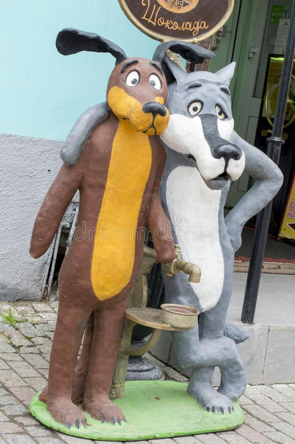 Dolls dog and wolf are on the streets of the city and offer hot chocolate. Sculpture. stock illustration