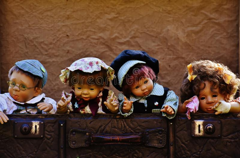 Dolls in suitcase royalty free stock photo