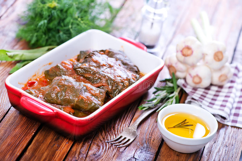 Dolma. With sauce in the bowl and on a table stock photos