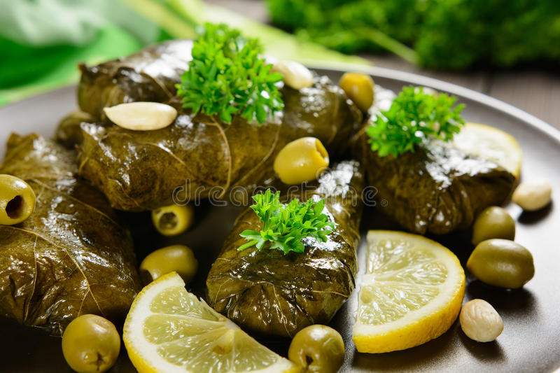 Dolma - stuffed grape leaves with rice and vegetable stock photos