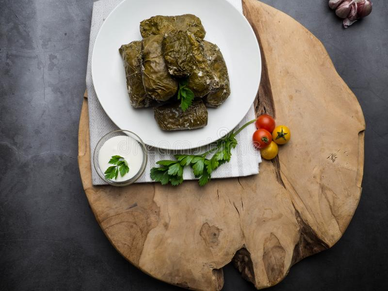 Dolma tolma, sarma - stuffed grape leaves with rice and meat. Traditional Caucasian, Ottoman, Turkish and Greek cuisine. Georgian dolma in grape leaves on stock images