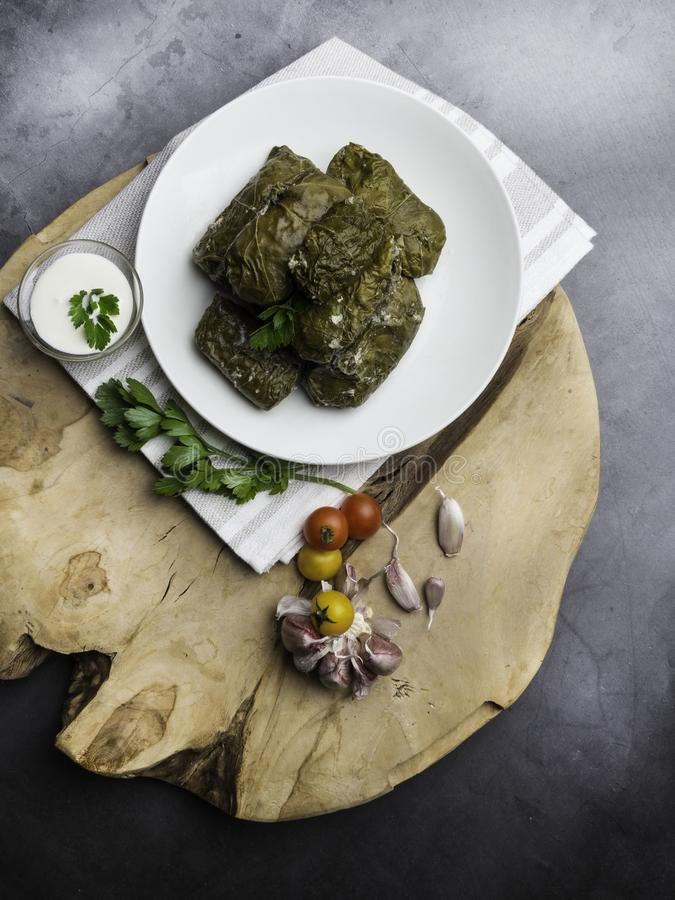 Dolma tolma, sarma - stuffed grape leaves with rice and meat. Traditional Caucasian, Ottoman, Turkish and Greek cuisine royalty free stock photo