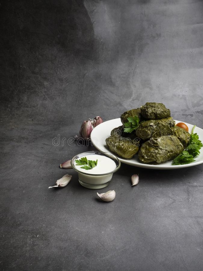 Dolma tolma, sarma - stuffed grape leaves with rice and meat. Traditional Caucasian, Ottoman, Turkish and Greek cuisine stock photos