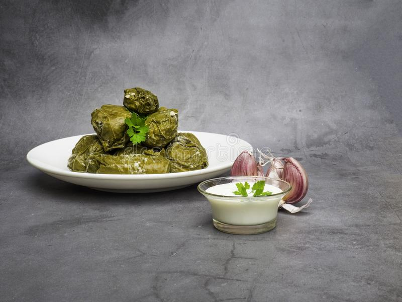 Dolma tolma, sarma - stuffed grape leaves with rice and meat. Traditional Caucasian, Ottoman, Turkish and Greek cuisine stock images