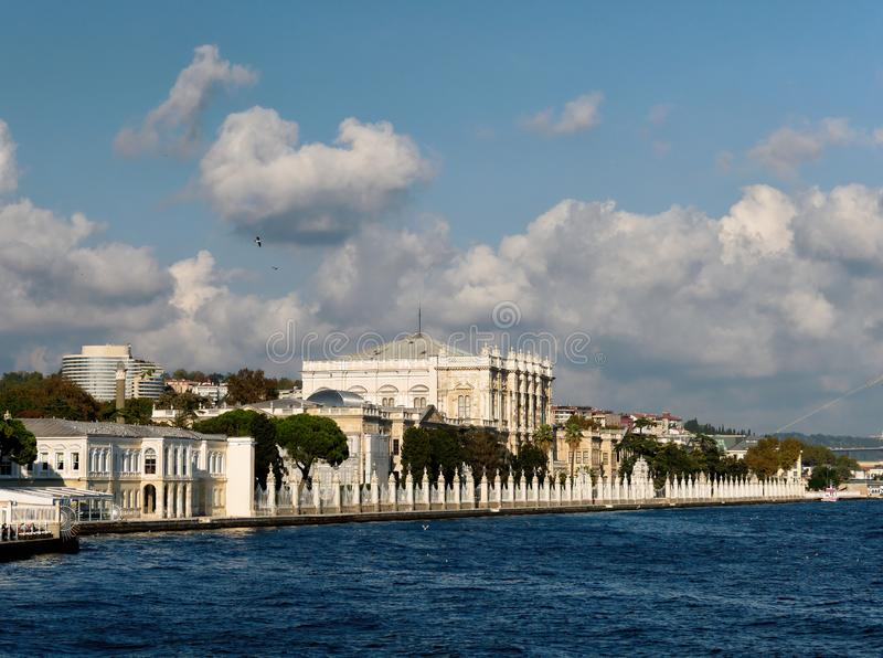 Dolmabahce Palace  on the bank of Bosphorus strait in Istanbul, Turkey. The beautiful and famous Dolmabahce Palace situated on the bank of Bosphorus strait in royalty free stock photos