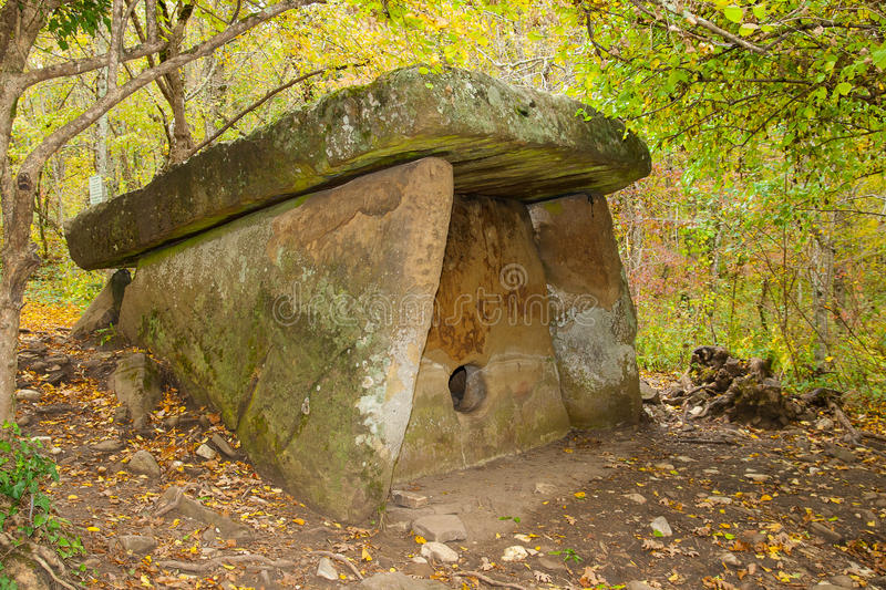 Dolmen is in the autumn forest. royalty free stock photo