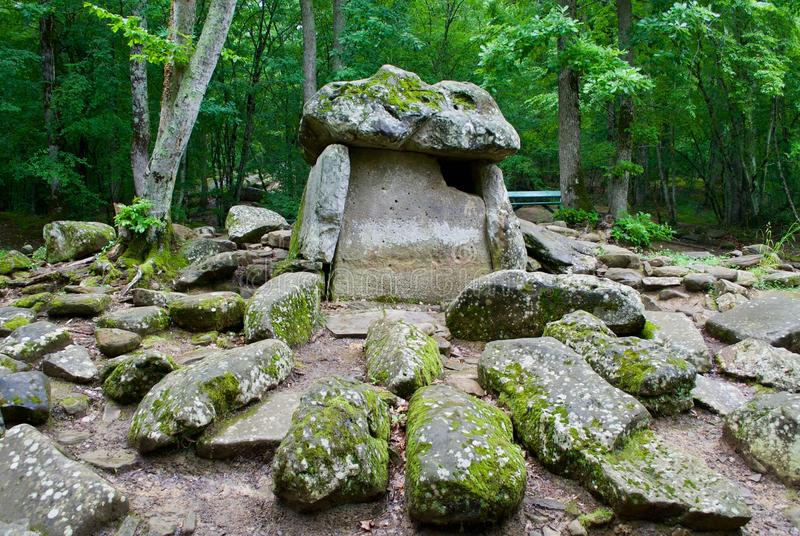 Dolmen in the forest. royalty free stock images
