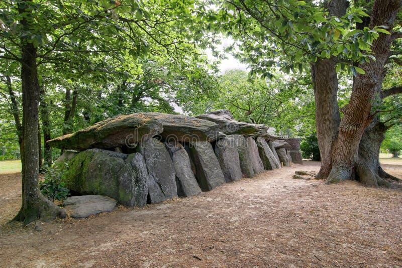 Dolmen La Roche-aux-Fees, Brittany, France. Dolmen La Roche-aux-Fees or The Fairies` Rock is a Neolithic passage grave - dolmen - located in the commune of Esse stock photo