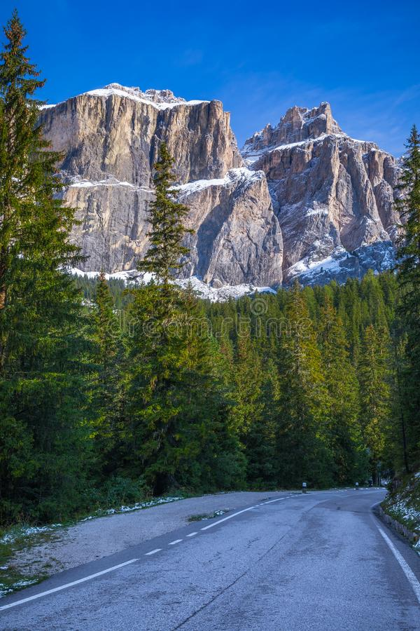 Dolomite Alps in Italy. Beautiful day. The road passes in the co stock photo