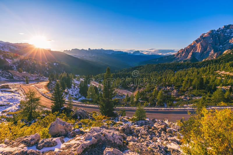 Dolomite Alps in Italy. Beautiful day. The road passes in the co stock photos