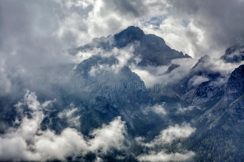 Dolomite mountains wrapped in clouds royalty free stock photo