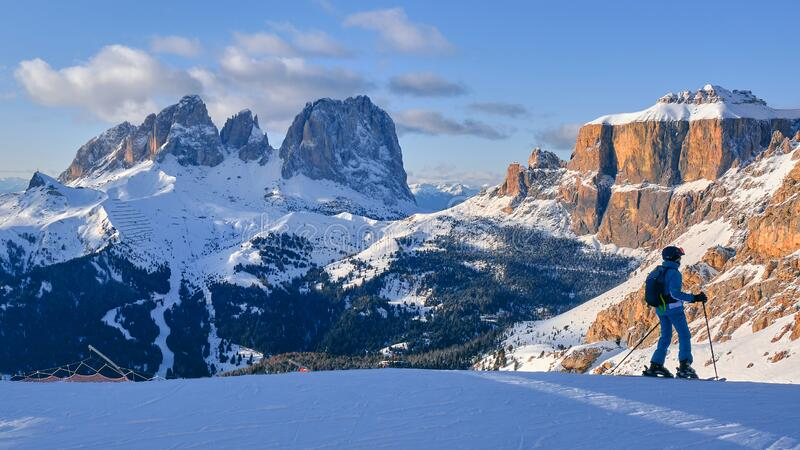 Ski domain Dolomiti Superski with panoramic views of Sassolungo and Sella group, at sunset. Dolomites, Italy - January 19, 2020: Ski domain Dolomiti Superski royalty free stock images