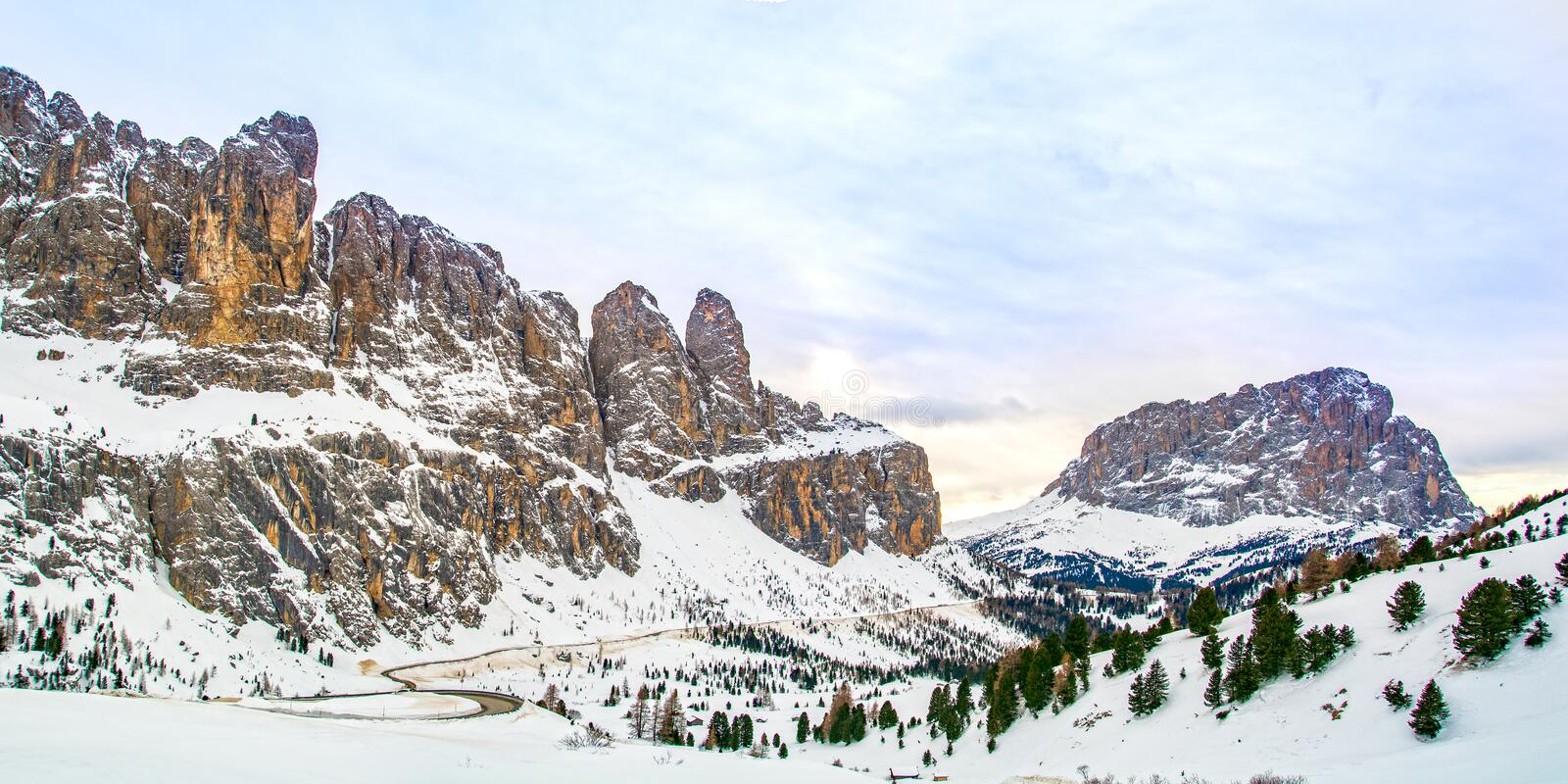 Dolomites landscape panorama in winter, Italy, Passo Gardena mountain pass royalty free stock images