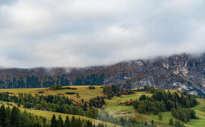 Dolomites mountain landscape cover with low cloud in autumn in Alpe di siusi, Italy stock photos