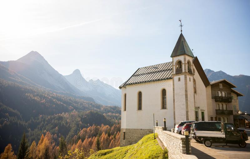 Dolomites. A white little chapel on the background of mountains royalty free stock photos