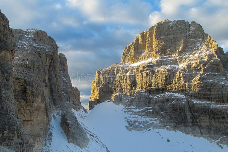 Rocky cliffs tower of Dolomites mountains above the pass, Dolomiti di Brenta. Dolomiti di Brenta, Italy, the Dolomites. Beautiful rocky peak mountains Alps at royalty free stock photos