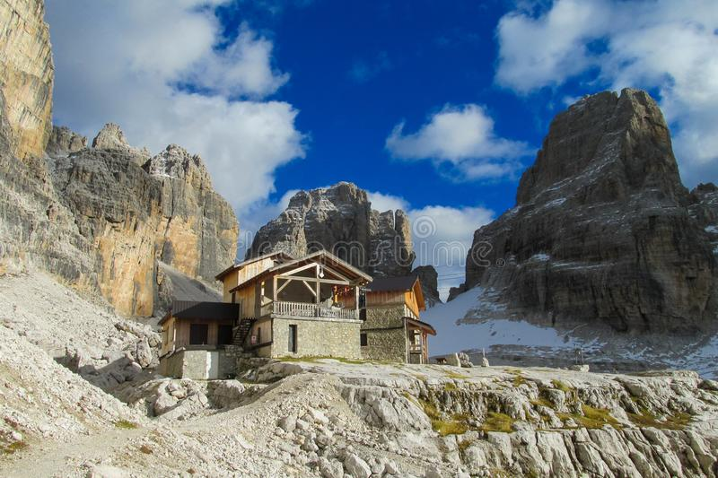 Dolomiti di Brenta refuge mountain hut Rifugio Alimonta. Dolomiti di Brenta refuge mountain hut , Italy, the Dolomites. Beautiful rocky peak tower mountains Alps royalty free stock photo