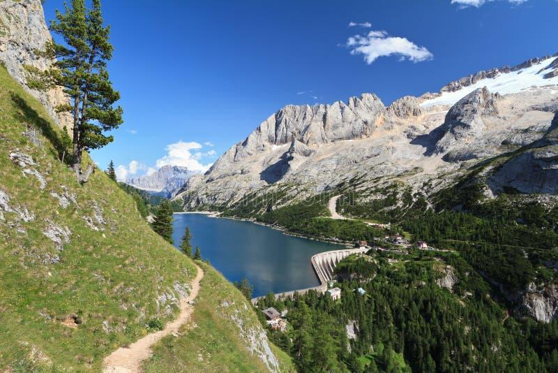 Dolomiti - Fedaia pass with lake stock photos