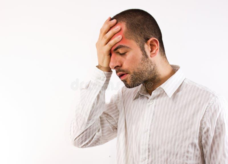 Dolor de cabeza en el trabajo imagen de archivo libre de regalías