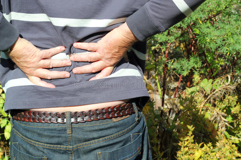 Dolor de espalda. foto de archivo libre de regalías