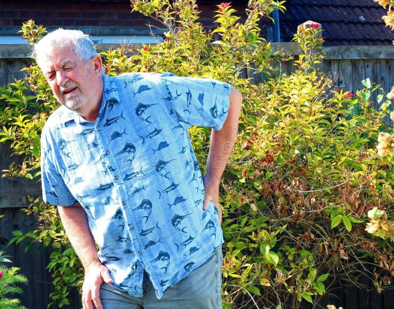 Dolor de espalda Artritis o ciática Mayor en dolor foto de archivo libre de regalías