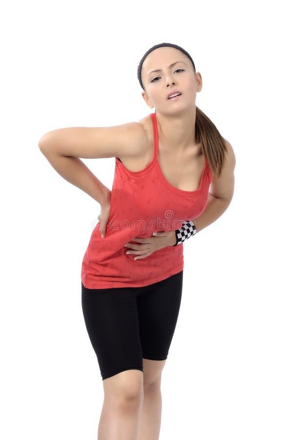 Dolor de espalda de la mujer fotos de archivo