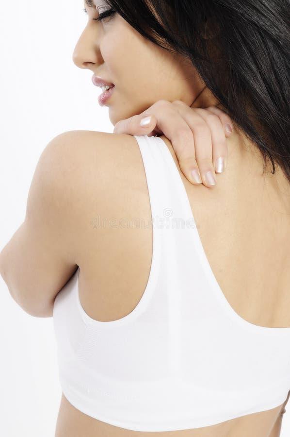 Dolor de espalda de la mujer imagen de archivo libre de regalías