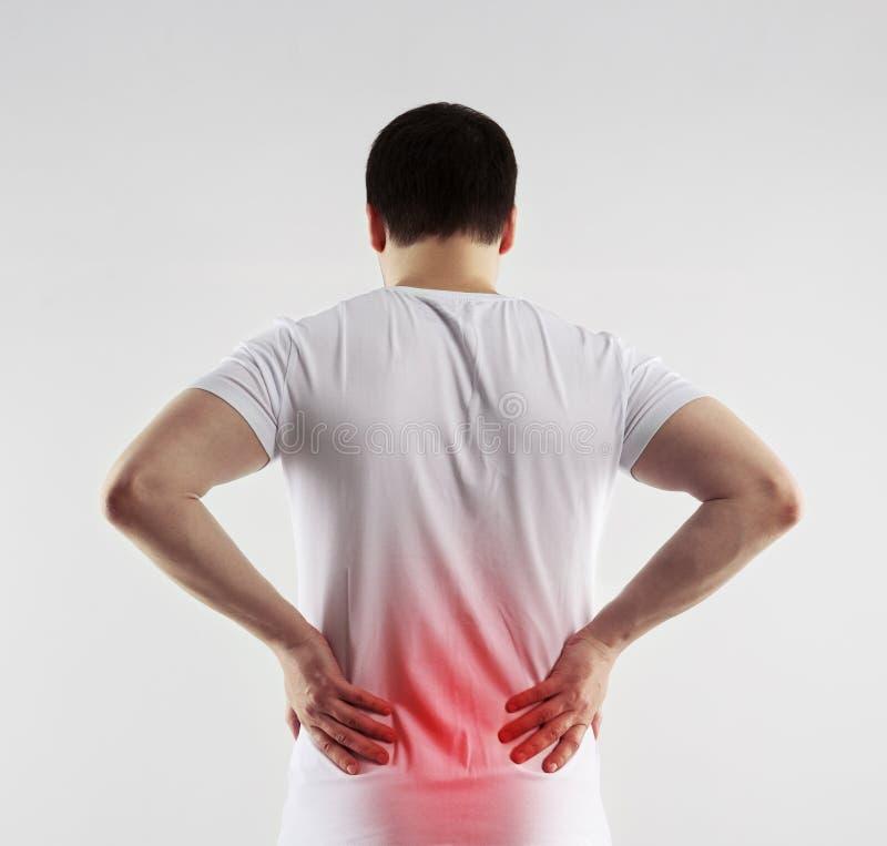 Dolor de espalda del hombre foto de archivo libre de regalías